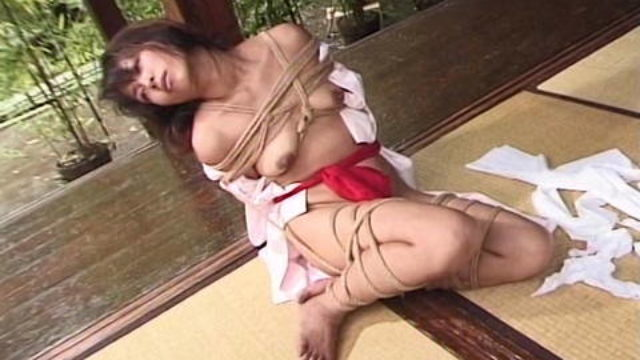 Japanese Held In Rope Bondage Outdoors By Dom